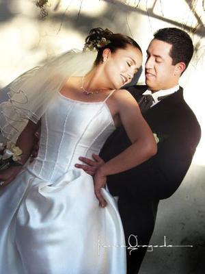 Ing. Jorge Antonio Gómez Venegas y Lic. Ma. Elizabeth Durán Zarzoza contrajeron matrimonio el 21 de marzo de 2003
