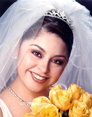 Lic. Elba Lucila Olvera  Gutiérrez contrajo matrimonio con el Ing Absalom Ruiz Rosales el 21 de Marzo de 2003.