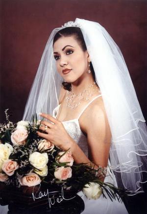 Srita. Gloria Érika  contrajo matrimonio con el Lic. Érik Armando Salazar de la Rosa el 15 de marzo de 2003