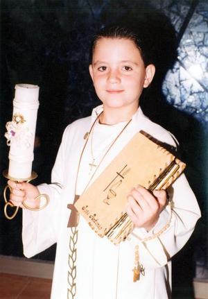 José Antonio Cuerda del Moral, hijo de Carlos Cuerda Carpio y Mónica del Moral de Cuerda el día que celebró su Primera Vomunión