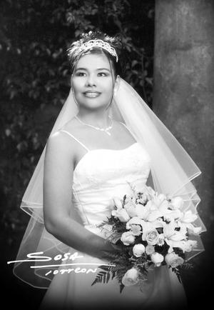 Srita. Wendy Triana Triana el día de su enlace nupcial con Sr. Román Burguette.  <p> <i>Studio Sosa</i>