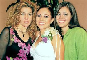 -Élida Tirado Medina, Ivonne Mendoza Tirado y  Mónica Olmos.