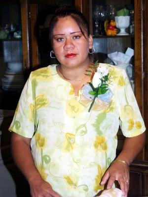 Edith Marcela Zapata de Barrera captada en la fiesta de canastilla que le organizó  Julieta de Zapata.