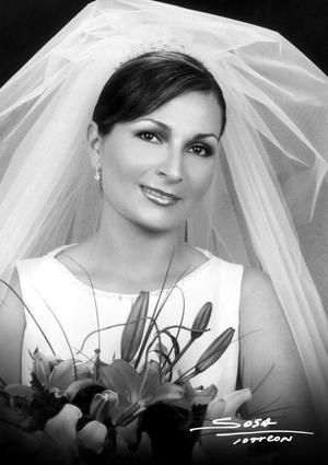 C.P. Mónica Rodríguez  Marín unió su vida en el Sacramento del matrimonio a la del Ing. Ernesto Alejadnro Meléndez Reyes.  <p> <i>Studio Sosa</i>
