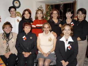 Fueron captadas en una reunión navideña, las señoras Pereyra.