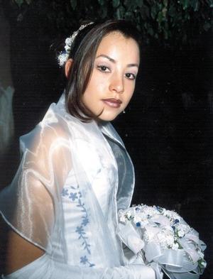 Srita. Nidia América Gómez Sánchez celebró su décimo quinto aniversario de vida el 31 de diciembre de 2003.