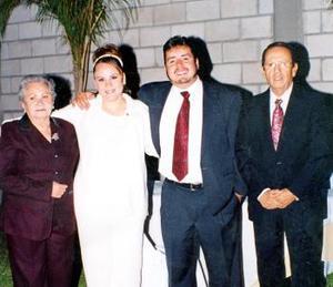 Alejandro Tinoco Torres, Claudia Torres López, Román Torres y Aurora López de Torres.