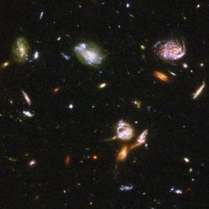 Esta nueva visión del Universo en su infancia fue posible gracias a dos imágenes captadas por la Cámara Avanzada para Reconocimientos (ACS, en inglés), instalada en el telescopio espacial en 2002, y la Cámara Casi Infrarroja y Espectrómetro para Objetos Múltiples (NICMOS).