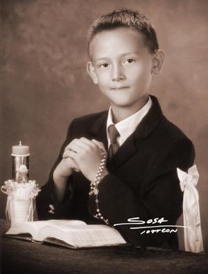 Niño Jorge Alberto Villarreal Perches en una fotografía de estudio el día que recibió la Sagrada eucaristía de la comunión.