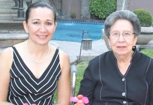Elisa Corrales Viesca y Elisa E. de Corrales.