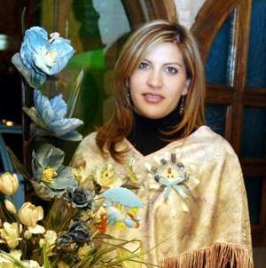 <u><i> 30 de noviembre de 2004</u></i><p> Marcela Mancha de Huerta  fue captada en su fiesta de canastilla.
