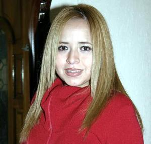 <b>03 de diciembre de 2004</b> <p> Nidia Argentina Ortiz Guerrero, captada en reciente festejo social.