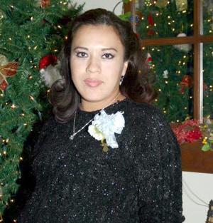 <b>14 de diciembre de 2004</b> <p>  Claudia Susana Robles espera disfrutó de una fiesta de canastilla por la próxima llegada de su bebé.