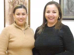 Eva Torres de García y Claudia  Reyes de Uribe.
