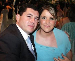 Carlos A. Revollo y Ale A. de Rebollo.