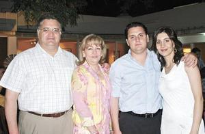 Los abuelos paternos Javier Mijares y Rosario A. de Mijares acompañando a Arturo Mijares y Sofía Papadópulos de Mijares en el bautizo de su hija María Emilia.