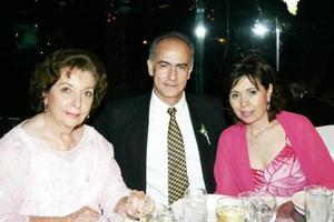 Nuri Civit, José Brunet y Maguis Z. de Brunet.