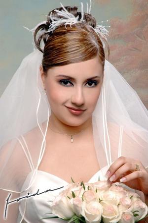 Srita. Nadia Leticia Vázquez López, el día de su enlace matrimonial, con el Sr. Jehu Heber Carranza Mancha.  <p> <i>Estudio fotográfico: Frida</i>