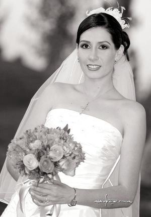 Srita. Diana Carrete Montes el día de su enlace nupcial con el Sr. Manuel de la Parra Martínez.  <p> <i>Estudio: Maqueda</i>