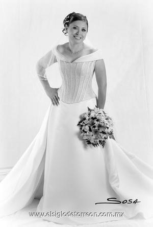 Srita. Nancy Lorena Muñoz Solís el día de su matrimonio con el Sr. Eloy Omar Soriano Andrade.  <p>  <i> Estudio: Sosa</i>