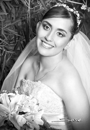 M.C. Isela Guadalupe Carrera Calderón el día de su boda con el M.C.Héctor Alonso Moreno Ávalos.  <p> <i>Estudio: Sosa</i>