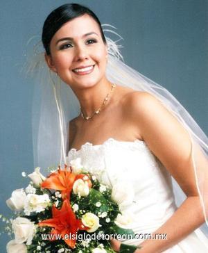 Lic. En Psic. Ana Cecilia Quiñones Medina el día de su boda con el Lic. Jorge Andrés Blando Torres.