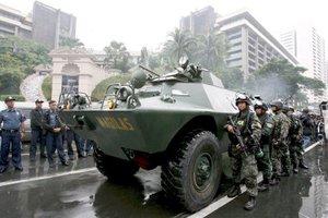 Las fuerzas de seguridad aplastaron el motín llevado a cabo por el grupo de militares atrincherados en un hotel de Makati, el distrito financiero de Manila, Filipinas.
