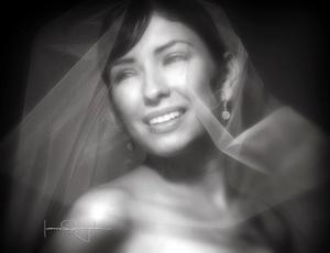 Srita. Laura Madel Marmolejo Rodríguez el día de su matrimonio religioso con el Sr. Melgem Hadad Facusseh. <p> <i>Estudio Laura Grageda</i>