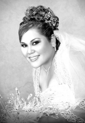 Srita. Nancy Roxana Escobedo Escobar, el día que contrajo matrimonio con el Sr. Adán Mijares Villalobos.  <p> <i>Studio Sosa</i>