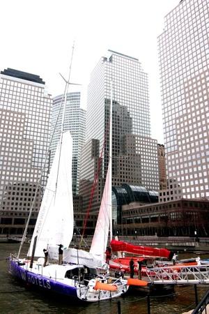 Vista de los barcos 'W Hotels'  y 'Estrella Damm', frente al World Financial Center, durante la inauguración de la exposición de la 'NY-BCN Transoceanic sailing Record', una competición que comienza el próximo 3 de abril en la bahía de Nueva York, y que establecerá el primer récord de navegación transoceánica entre Nueva York y Barcelona.