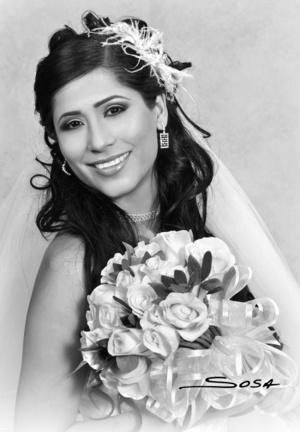 Lic. Laura Matilde Hernández Ramírez, el día de su boda con el Lic. Christian Álvarez Muñoz. <p> <i> Studio R. Sosa</i>