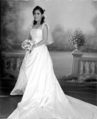 M.C.A. Adriana Patricia Medrano López el día que unió su vida a la del I.B.Q. Antonio Muñoz Muñoz. <p> <i> Fassio</i>