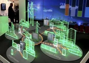 Visitantes observan un modelo iluminado de una red de producción, distribución y consumo energético en la Feria Industrial de Hannover.