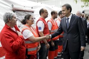 En una breve comparecencia ante la prensa en el propio recinto ferial antes del funeral, Rodríguez Zapatero destacó el compromiso del Gobierno con la reconstrucción de la ciudad.