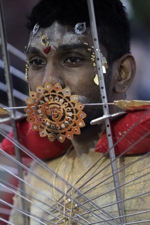 Es común ver a los hinduístas con diferentes perforaciones durante la festividad hinduísta de Thaipusam.