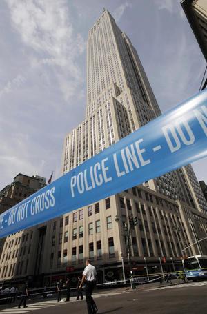 El tiroteo ocurrió frente al Empire State de Manhattan el cual dejo nueve heridos y dos muertos. (AP)