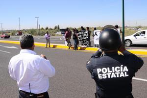 Elementos de la Policía Estatal estuvieron al tanto de la manifestación.