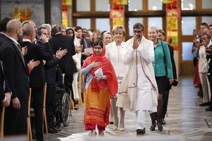 La llegada de Malala Yousafzai y Kailash Satyarthi a la ceremonia de entrega del Premio Nobel de la Paz en el Ayuntamiento de Oslo.