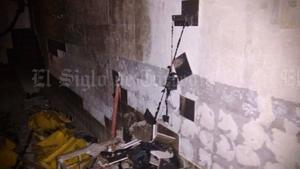 El incendio dejó daños en el cuarto de lavado del Hospital General de Matamoros.