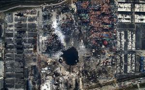 Imagen ganadora del tercer premio de la categoría de noticias de actualidad de la 59 edición del World Press Photo. La fotografía muestra una vista aérea de la destrucción causada por la explosión de Tianjin (China).