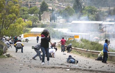 El choque entre uniformados y civiles se extendió durante cinco horas, tiempo en el que se registraron detonaciones con armas de fuego.