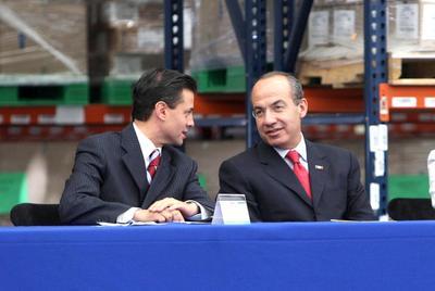 Peña en reunión con el entonces presidente, Felipe Calderón.