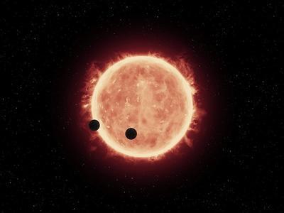 Fotografía cedida por la NASA, muestra la ilustración de dos planetas del tamaño de la tierra llamados, TRAPENSE-1B y TRAPENSE-1C, que pasando por delante de una estrella enana roja, que es mucho más pequeña y fría que nuestro sol.