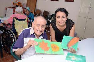 05082016 EN EL TALLER DE PINTURA.  Marco Antonio Ramírez y Teresa Hernández.