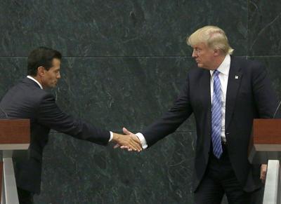 """En la ronda de preguntas de la prensa, el republicano fue cuestionado si en la reunión se trató quién va a pagar sobre el muro, lo que rechazó. """"Sí hablamos del muro, pero no de quién lo va a pagar... eso sería para una fecha posterior""""."""