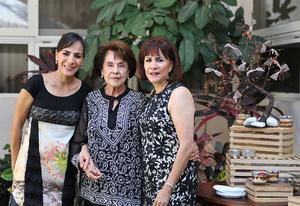 Con sus hijas, Iveth y Laura