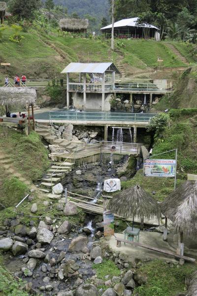 """NARANJAL (GUAYAS,ECUADOR).- Fotografía del complejo turístico """"Tsuer Entsa"""", situado en el cantón (municipio) de Naranjal, en la provincia de Guayas, al suroeste de Ecuador, compuesto de piscinas naturales de agua caliente y fría, un sencillo comedor, también usado para las exhibiciones de danza tradicional, y alojamiento, donde la comunidad indígena shuar ha trasladado a su emprendimiento turístico el uso de la medicina natural, que se sirve de las hierbas para sanar a los enfermos y emplea terapias como los baños termales. EFE"""