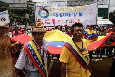 """En las elecciones participaron más de 8 millones de los casi 19,5 millones de venezolanos convocados a las urnas, de acuerdo con los datos del Consejo Nacional Electoral (CNE), números que son rechazados por la oposición, que asegura que el chavismo """"inventó"""" votos. EFE/Miguel Gutiérrez"""