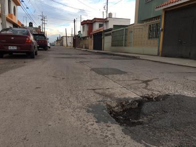 Calle Bravo entre González de la Vega y bulevar Durango.