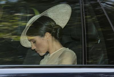 Meghan en su llegada al evento real en el Palacio de Buckingham.